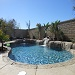 Beautiful in ground pool built in Moreno Valley, Ca with grey plaster and artificial rock coping and waterfall.