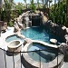 This beautiful pool is located in Yorba Linda it has a large grotto and slide, it also includes a slide.