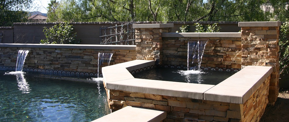 Pool built in southern California, includes stack stone masonry, pour in place concrete, and landscaping