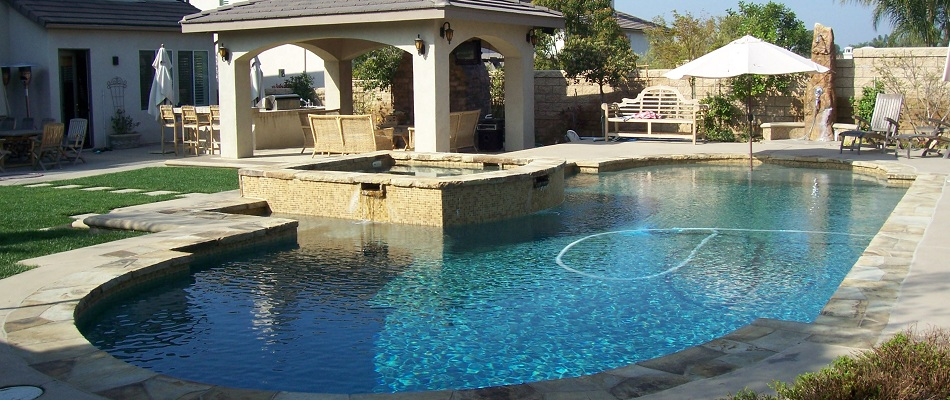 Swimming Pool with flagstone coping, traditional shape, with a patio constructed in Riverside.